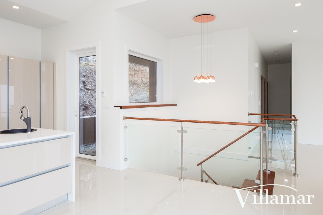 glass railing custom home build villamar kitchen