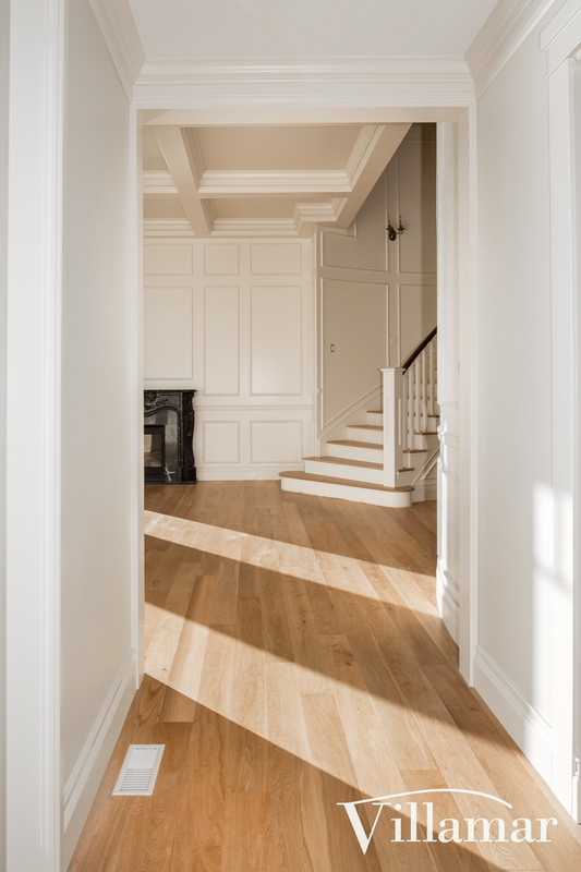 waterfront home builder hallway stairway traditional construction